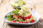 Couscous stuffed tomato — Stock Photo