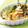 Farfalle with mushrooms - Stock Photo