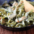 Spinach fettuccine with chicken, basil pesto and cream — Stock Photo #4386259