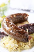 Sausages, sauerkraut and baked potato — Stock Photo