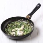Stir frying spring onion and garlic — Stock Photo