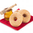 Donuts and honey — Stock Photo