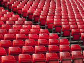 Rows of red seats — Stockfoto