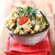 Spinach fettuccine with chicken, basil pesto and cream — Stock Photo #4962509