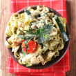 Spinach fettuccine with chicken, basil pesto and cream — Stock Photo #4962512