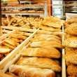 Variety of bread in a supermarket — Stock Photo
