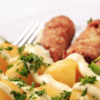 Cevapcici and potatoes - Stock Photo