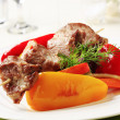 Roasted meat on skewer and baked vegetable - Stock Photo