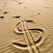 Dollar sign in the sand — Stock Photo