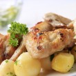Roasted chicken wings and potatoes — Stock Photo #5217773