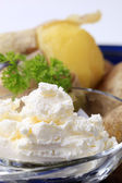 Potatoes and cottage cheese — Stock Photo