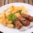 Постер, плакат: Cevapcici and potatoes