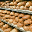 Stock Photo: Loaves of bread on shelves