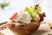 Baked potato and cream cheese — Stock Photo