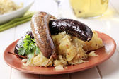 Blood sausage and white pudding — Stock Photo