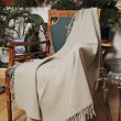 Throw draped over an antique chair — Stock Photo