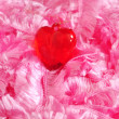 Red heart on a pink background — Stock Photo