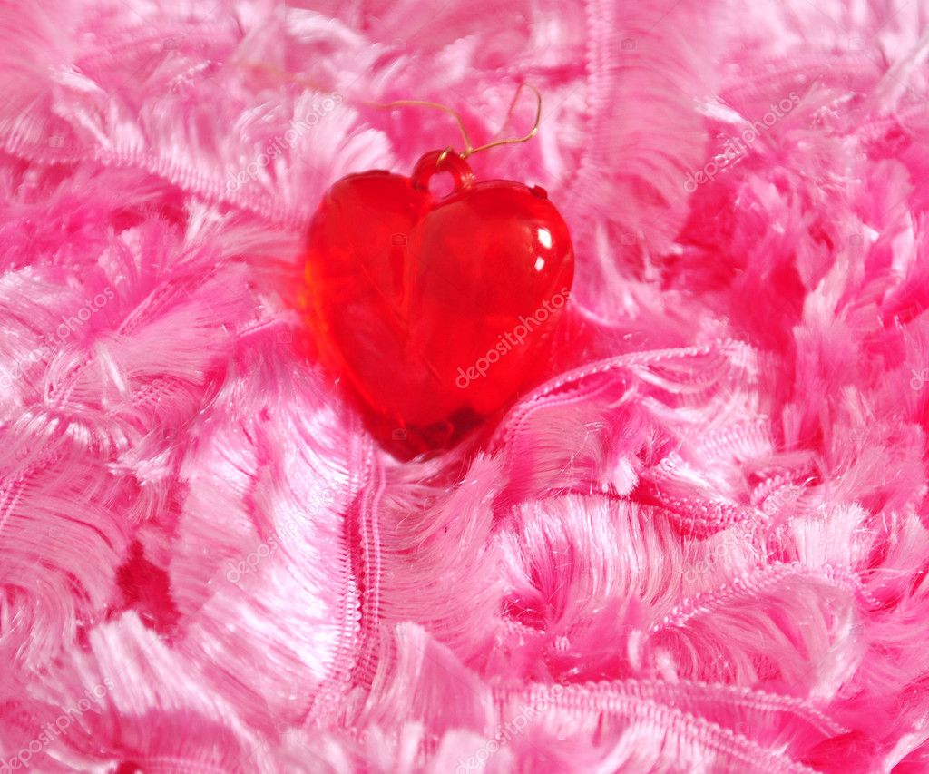 free pink background images. Red heart on a pink background