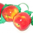 Red apples with a centimeter tape — Stock Photo