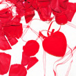 The petals of roses and hearts on a white background — Stock Photo