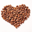 Coffee beans in shape of heart on a white background — Stock Photo