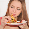 Young girl eating pizza - Stock Photo