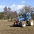 Stock Photo: Tractor cultivating