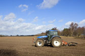 Tractor cultivating — Stock Photo