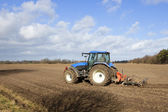 Blue tractor cultivating 2 — Stock Photo