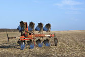 Red plow in a field 2 — Stock Photo
