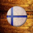 Royalty-Free Stock Photo: Finnish Grunge Flag on a wooden background