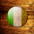 Irish Grunge Flag on a wooden background — Stock Photo