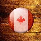 Canadian Grunge Flag on a wooden background — Stock Photo
