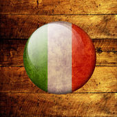 Italian Grunge Flag on a wooden background — Stock Photo