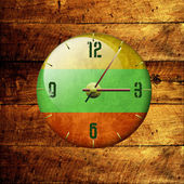Vintage clock with arrows- lithuania — Stock Photo