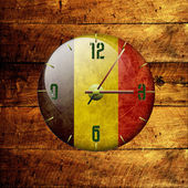 Vintage clock with arrows-belgium — Stock Photo