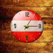 Vintage clock with arrows- austria — Stock Photo