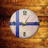 Vintage clock with arrows -finland — Stock Photo