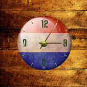 Vintage clock with arrows- netherlands — Stock Photo