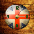 Vintage clock with arrows- British - Stock Photo