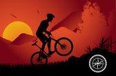 Mountain biker sunset background — Stock Vector