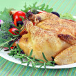 Roast hen on serving platter. — Stock Photo #4928790