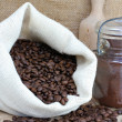 Coffee beans in a sack and Jar — Stock Photo