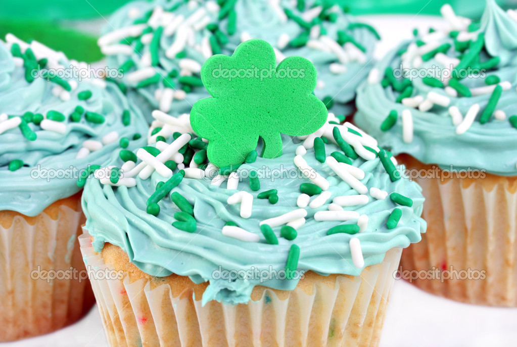 Festive cupcakes decorated with a shamrock for St. Patrick's Day.  Stock Photo #5017332