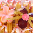 Pretty Soaps, bath beads and ribbons. — Stock Photo