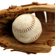 Stock Photo: Baseball glove and ball in pocket on white.