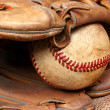 Old Baseball and Mitt - Stock Photo