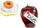 Diet Concept with Apple and Doughnut on white with copy space. — Stock Photo