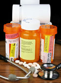 Medications with warnings and stethoscope-low key image and copy — Stock Photo