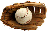 Baseball glove and ball in pocket on white. — Stock Photo